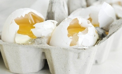 Image result for cracked eggs in carton