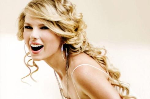 1235479-taylor-swift-woman-of-the-year-617-409